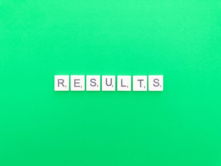 The word results spelt out in Scrabble tiles on a green background