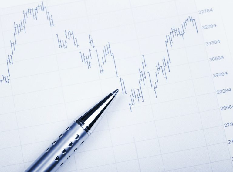 Stock exchange market chart with pen point to decrease
