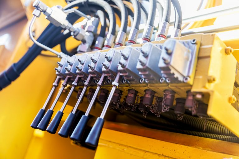 Row of levers on a yellow machine