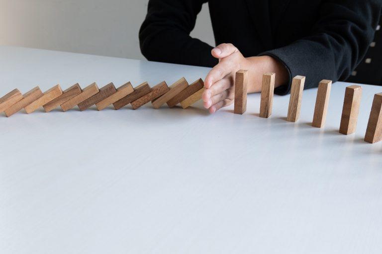 Building blocks falling in a line
