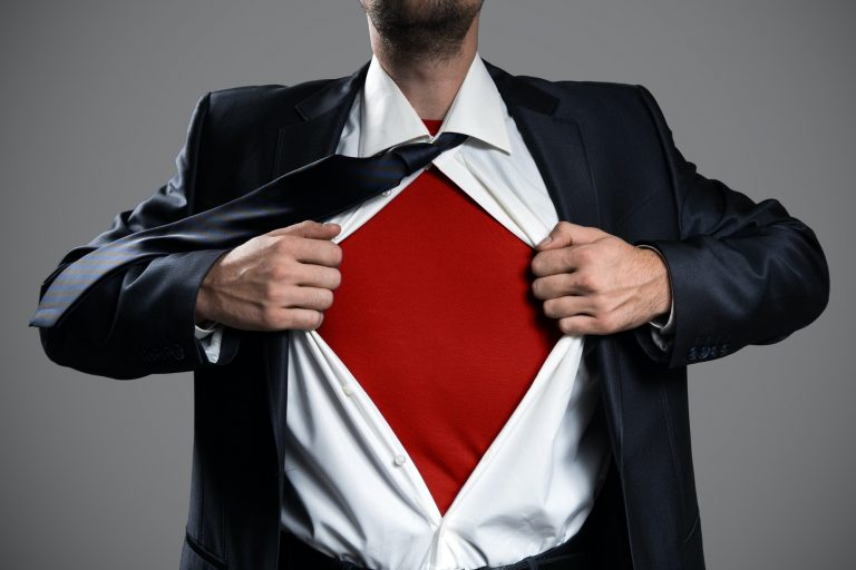 Businessman Acting Like A Super Hero And Tearing His Shirt