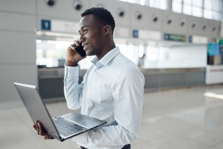 Businessman with phone and laptop negotiating
