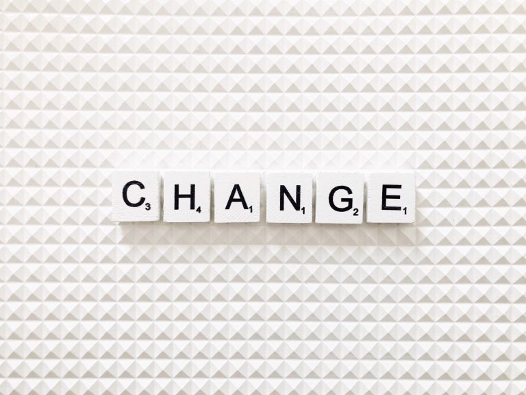 The word change spelt out in Scrabble tiles