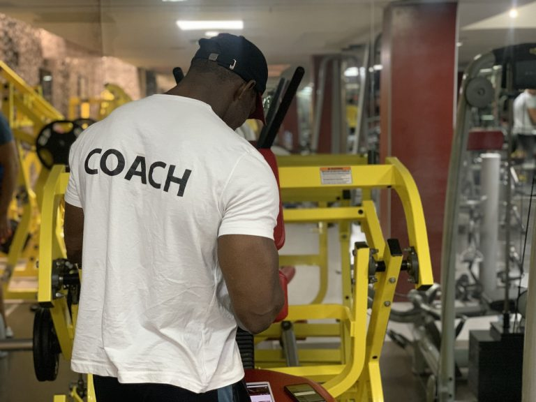 Man in gym with coach t-shirt on