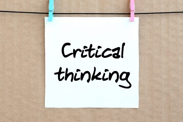 White paper pegged to a line that says Critical Thinking