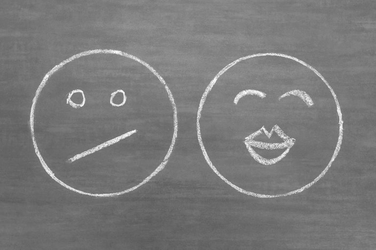 Drawing of a happy face and a sad face