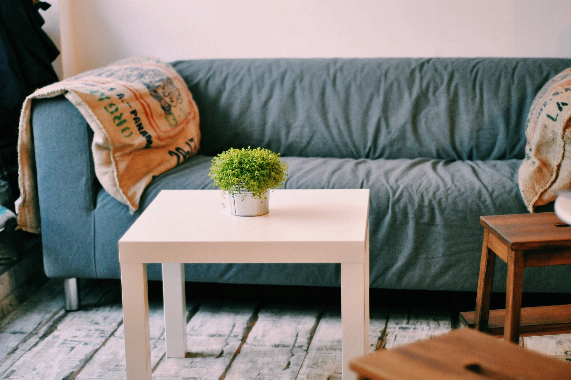 A sofa with cushions and a coffee table