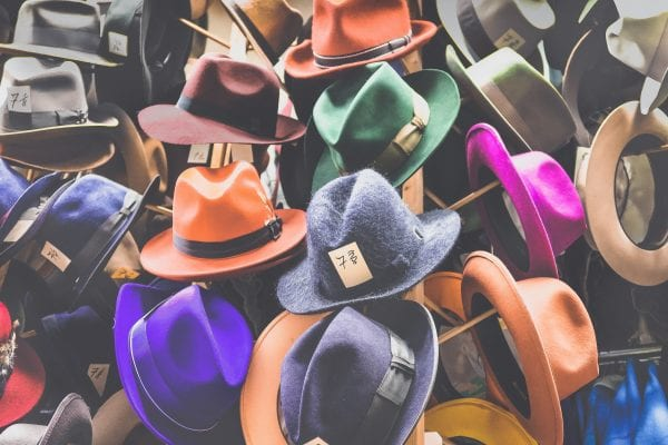 Coloured hats on a stand
