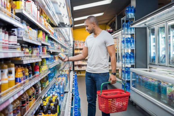 Man browsing supermarket shelf