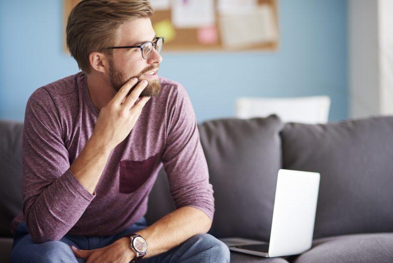 Man sitting on sofa and thinking