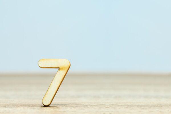 Gold number seven on blue background