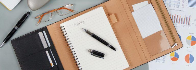 Opened agenda with handwritten MONDAY