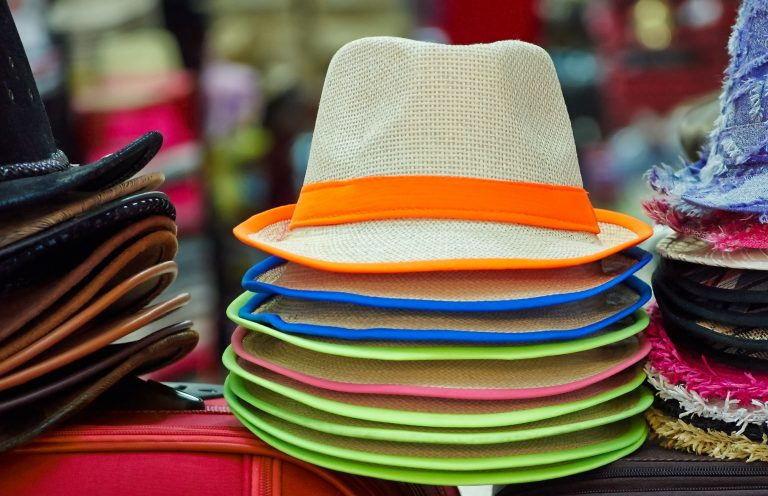 Pile of colorful hats on stand