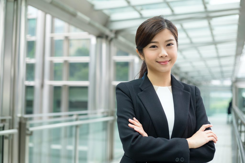 Professional business woman with arms folded