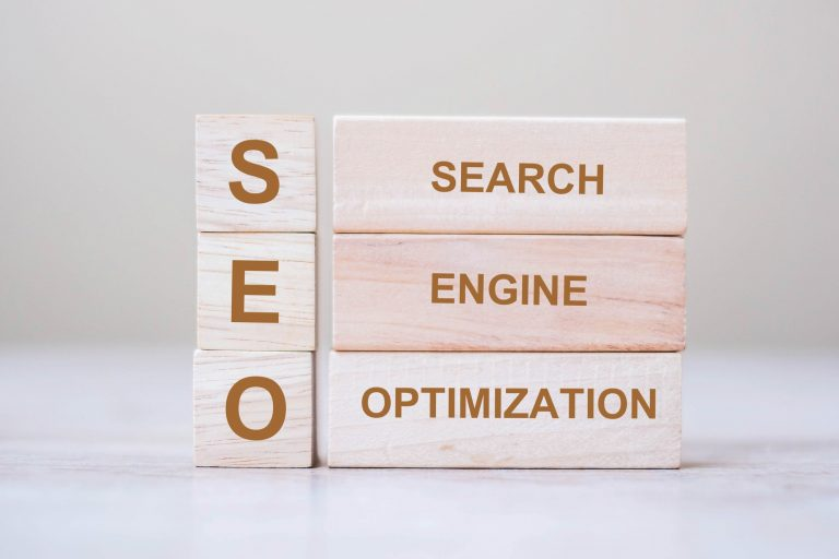 SEO on wooden blocks with three words next to it