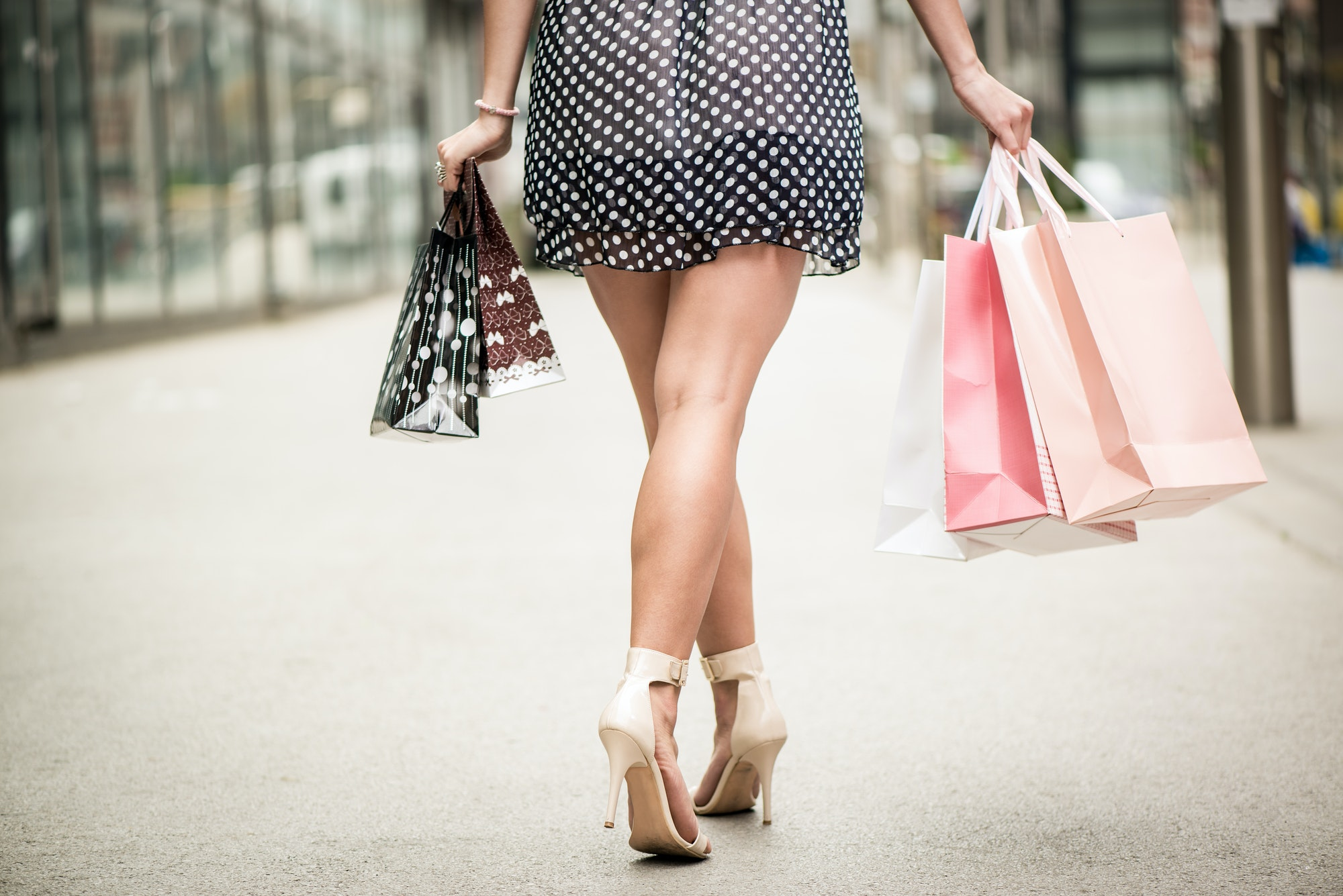 Close of of woman with shopping bags