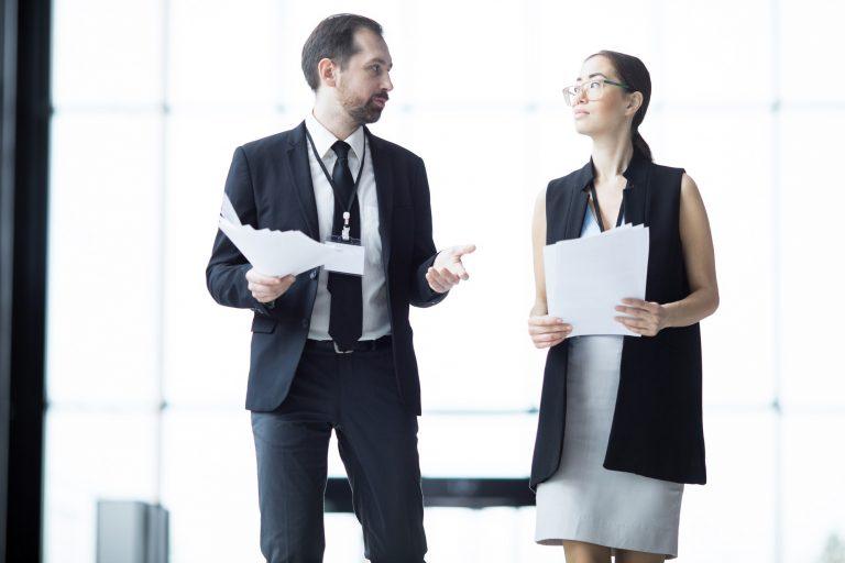 Businessman delegating to businesswoman