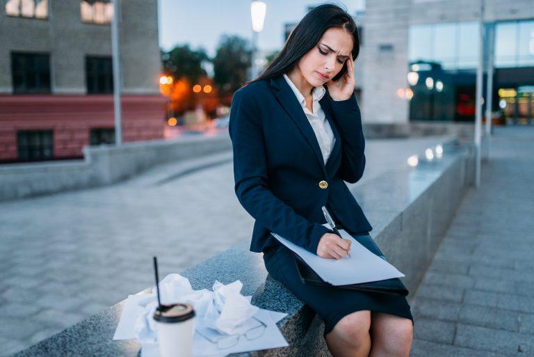 Businesswoman writing statements