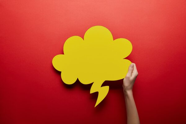 Yellow thought bubble on red background