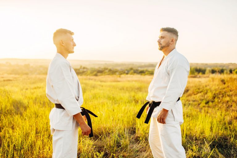 Karate coach and student outside