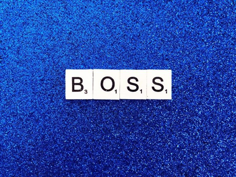 Scrabble tiles spelling Boss