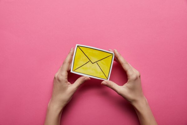 yellow email sign on pink background