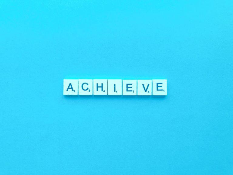 achieve spelt out in Scrabble tiles