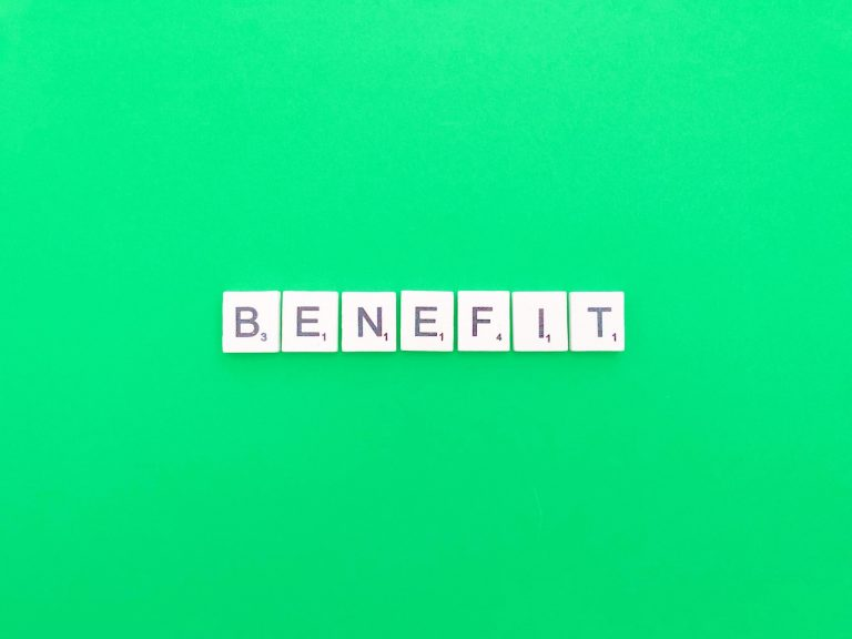 The word benefit spelt out in scrabble tiles