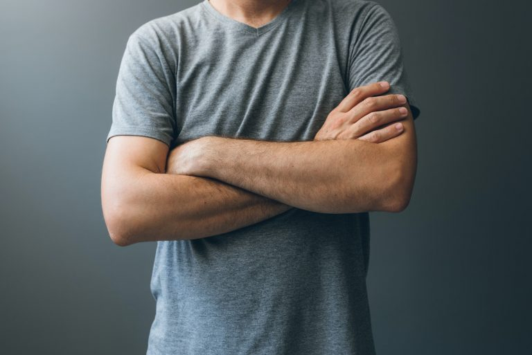 Casual adult man with arms crossed