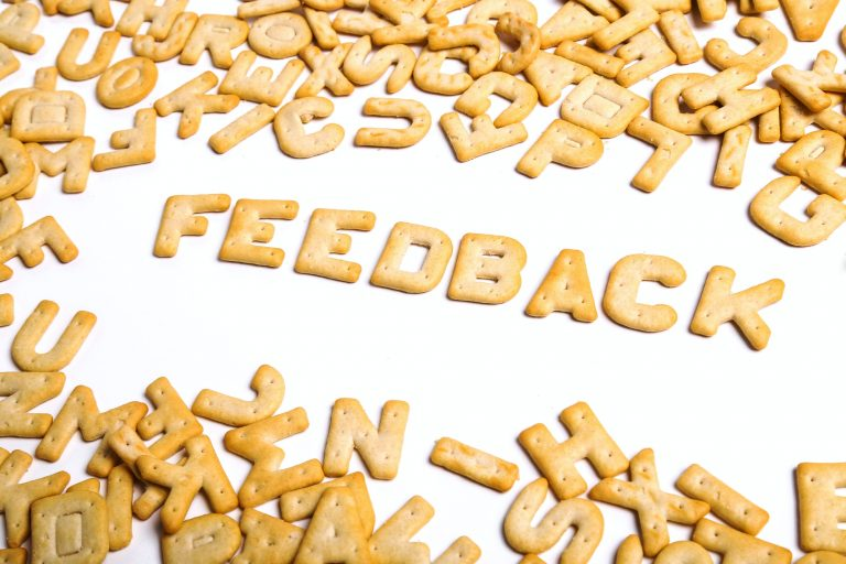 The word Feedback spelt out in biscuits