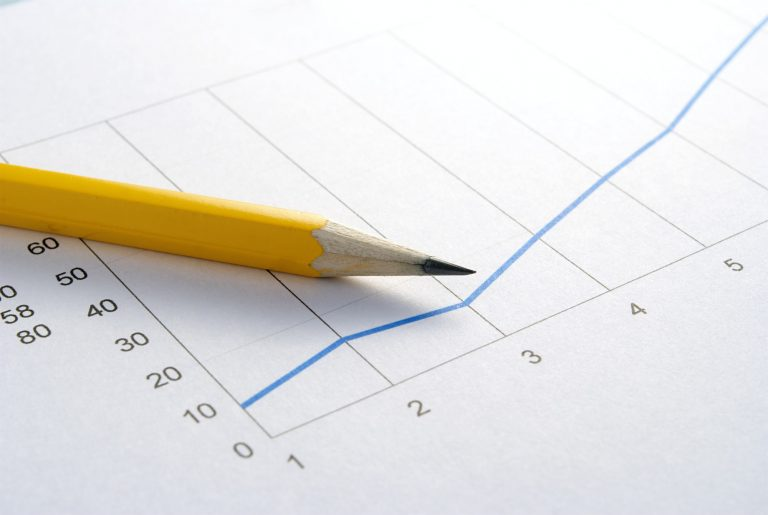 Pencil laid on a paper graph