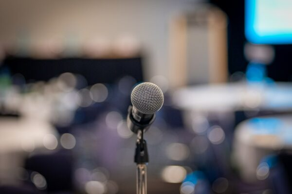 In focus microphone with background blurred