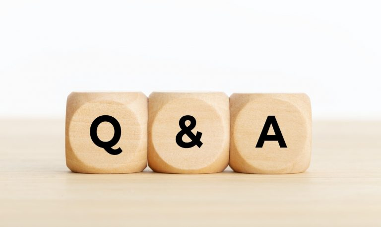 Wooden dice with Q &A on it