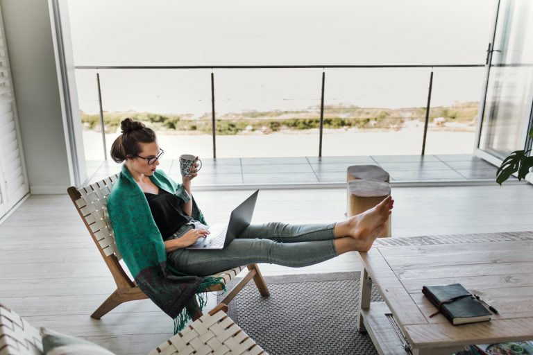 Woman working from home with feet on table