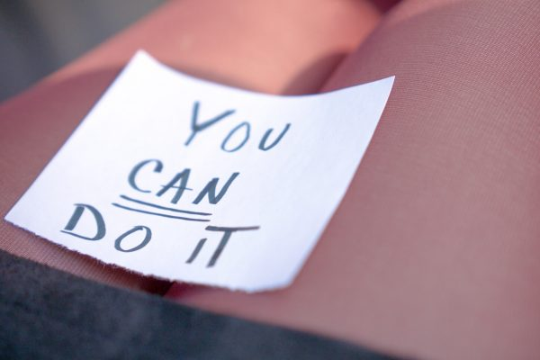You can do it encouragement note on woman's lap