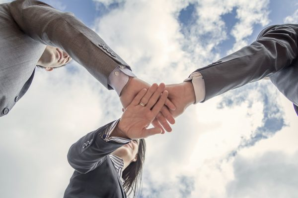 Business team showing unity with hands together