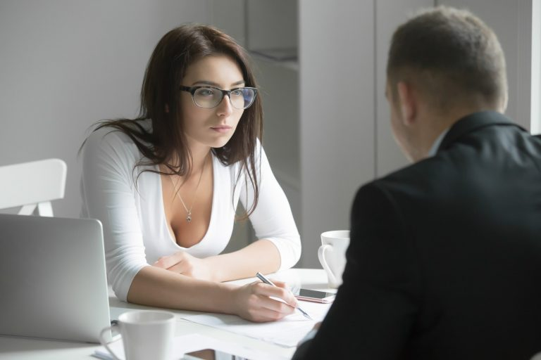 Businesswoman interviewing male business person