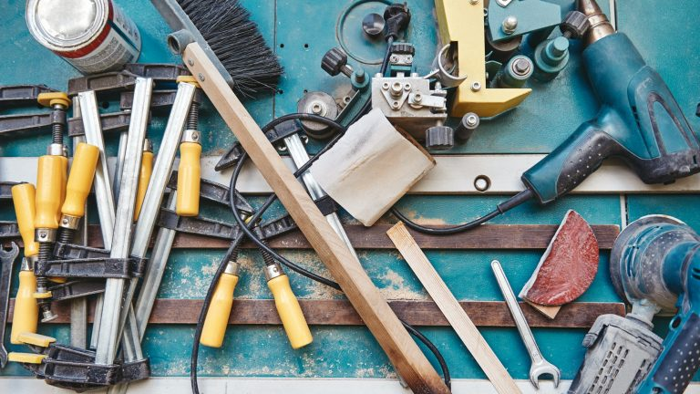 Many tools laid out on a blue surface