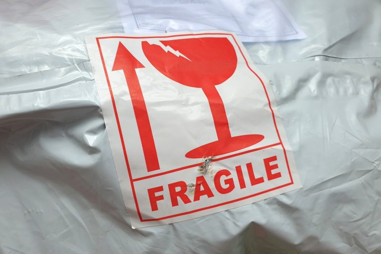 Fragile sticker on parcel packaging