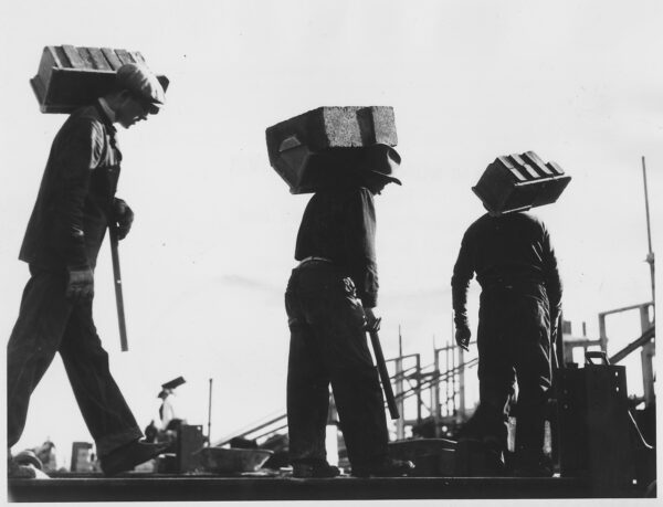 Black and white picture of hod carriers