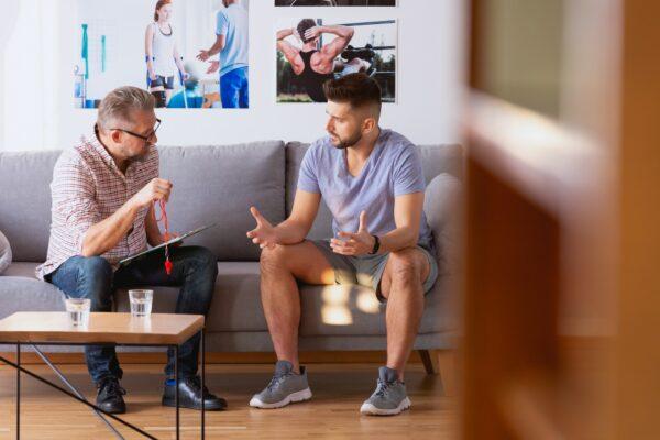 A man talking to his coach on a sofa