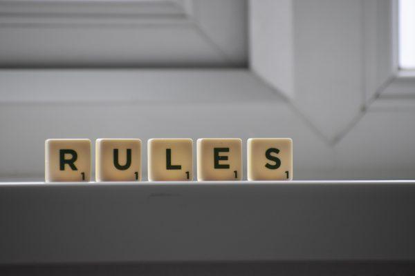 The word Ruled written in Scrabble tiles on a windowsill