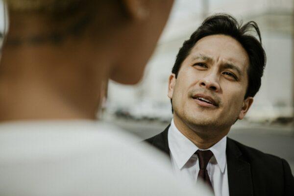 Thoughtful businessman in conversation