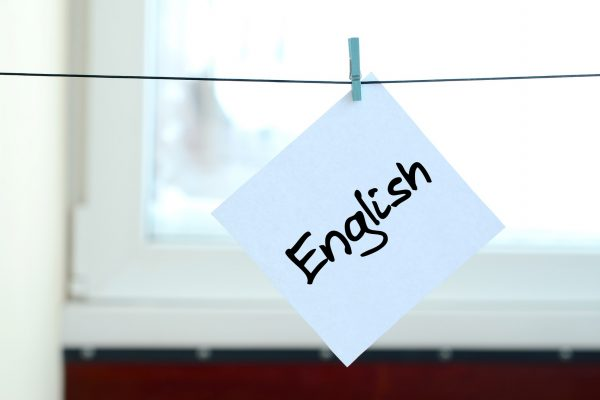Piece of paper pegged to a line with English on it